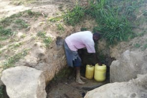 The Water Project: Elukho Community -  Fetching Water
