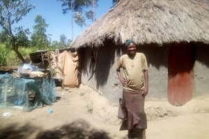 The Water Project: Lutonyi Community, Shihachi Spring -  Mrs Omosh Outside Her Grass Thatched House