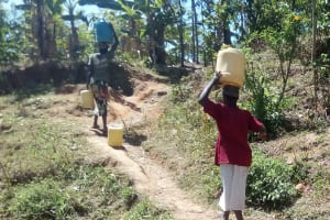 The Water Project: Handidi Community, Matunda Spring -  Carrying Water