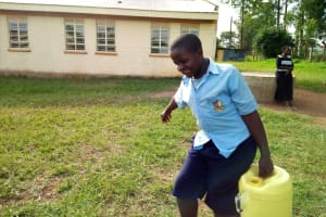 The Water Project: Mumias Central Primary School -  Erick Carrying A Full Container
