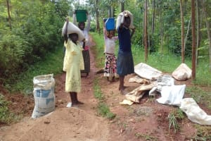 The Water Project: Visiru Community, Kitinga Spring -  Collecting Materials