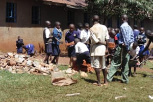 The Water Project: Ebusiloli Primary School -  Students Shuttling Bricks To The Artisans