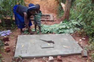 The Water Project: Visiru Community, Kitinga Spring -  Mrs Mwinamo At Her Newly Casted Platform