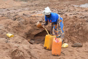 The Water Project: Ikulya Community -  Fetching Water