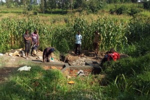 The Water Project: Handidi Community, Malezi Spring -  Locals Inspect Progress On Their Spring