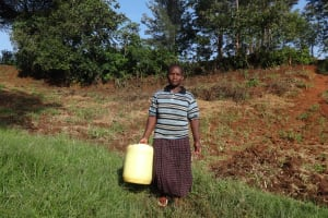 The Water Project: Shitungu Community, Makale Spring -  Mrs Makale Heading To The Spring