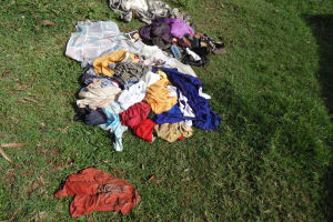 The Water Project: Ebuhando Community, Christopher Omasaba Spring -  Clothes On Ground