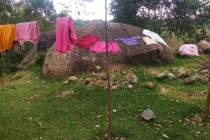The Water Project: Ematiha Community, Ayubu Spring -  Clothes Drying On Ground