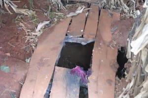 The Water Project: Ebuhando Community, Christopher Omasaba Spring -  Latrine Floor