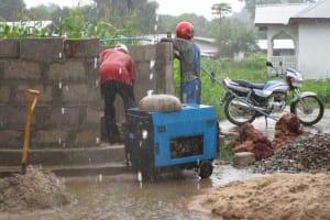 The Water Project: Benke Community, Brima Lane -  Working In The Rain