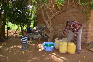 The Water Project: Ngaa Community A -  Household Water Containers