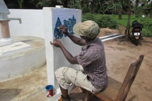 The Water Project: Kitonki Community, War Wounded Camp -  Painting The Logo