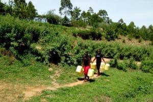 The Water Project: Kakubudu Community, Fred Lagueni Spring -  Women Going To Fetch Water