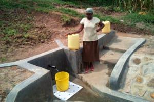 The Water Project: Handidi Community, Malezi Spring -  Mrs Grace Malezi At The Spring