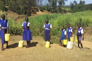 The Water Project: Ematiha Community, Ayubu Spring -  Students Waiting In Line At The Spring