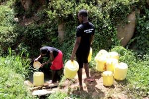 The Water Project: Kakubudu Community, Fred Lagueni Spring -  Fetching Water