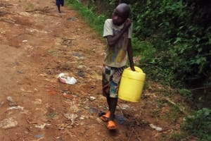 The Water Project: Bushevo Community, David Enani Spring -  Brian Weke Going To The Spring To Fetch Water