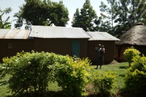The Water Project: Chegulo Community, Shakava Spring -  Lady And Child Who Rely On Shakava Spring