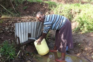 The Water Project: Shitungu Community, Makale Spring -  Fetching Water