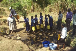 The Water Project: Ematiha Community, Ayubu Spring -  Community Members And Students Waiting In Line