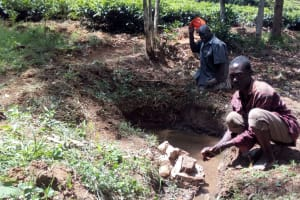 The Water Project: Mkunzulu Community, Museywa Spring -  Man Washing His Hands In Spring