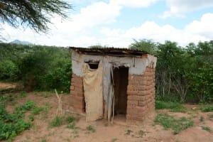 The Water Project: Kaani Community E -  Justina Pius Household Latrine