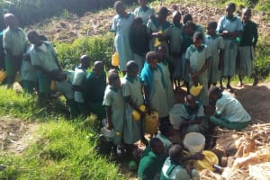 The Water Project: Eshilakwe Primary School -  Fetching Water