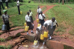 The Water Project: Evojo Secondary School -  Students At Mwabianga Spring