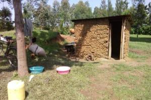 The Water Project: Chegulo Community, Shakava Spring -  Traditional Mud Latrine
