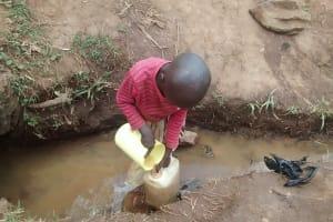 The Water Project: Lugango Community, Lugango Spring -  Girl Drawing Water