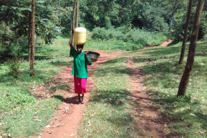The Water Project: Mudete Community, Wadimbu Spring -  Carrying Water From The Spring