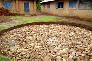 The Water Project: Kakubudu Primary School -  Building A Solid Foundaction For Rain Tank