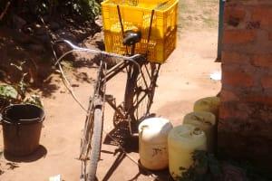 The Water Project: Futsi Fuvili Community, Patrick Munyalo Spring -  Water Containers
