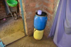 The Water Project: Kaani Community E -  Rose Nduku Hand Washing
