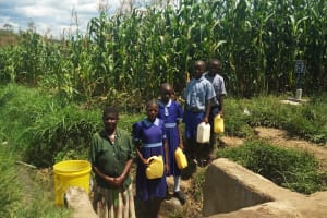 The Water Project: Namalenge Primary School -  Fetching Water