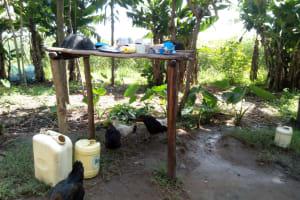 The Water Project: Chegulo Community, Shakava Spring -  Sample Dishrack