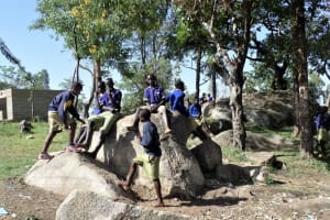 The Water Project: Shiyunzu Primary School -  Boys Relaxing On The Rocks Outside