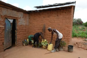 The Water Project: Kaani Community E -  Benjamin Household Watering Plants