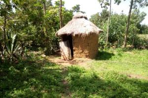 The Water Project: Chegulo Community, Shakava Spring -  Sample Latrine