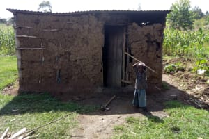 The Water Project:  A Child Outside His Home