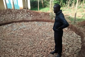 The Water Project: Mukhombe Primary School -  Field Officer Inspecting Foundation Work