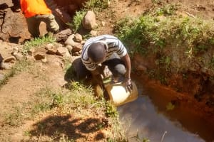 The Water Project: Shitoto Community, Abraham Spring -  Mr Columba Fetching Water For Construction