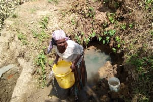 The Water Project: Shikoti Community -  Woman Fetching Water During Construction
