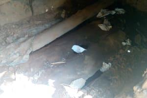 The Water Project: Mkunzulu Community, Museywa Spring -  Dangerous Latrine Floor