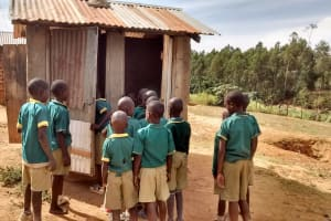The Water Project: Buhunyilu Primary School -  Line To Use Latrines