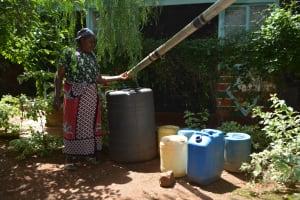 The Water Project: Kaani Community E -  Catching Rainwater