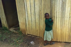The Water Project: Eshilakwe Primary School -  Little Girl In Front Of Latrines