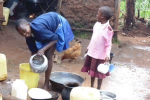 The Water Project: Ebuhando Community, Christopher Omasaba Spring -  Alice And Little Sister Washing Utensils