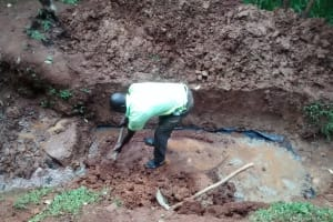The Water Project: Wamuhila Community, Isabwa Spring -  Artisan Excavating The Spring
