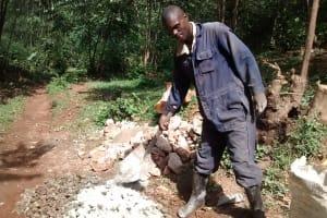 The Water Project: Wamuhila Community, Isabwa Spring -  Mr Anziva Helping The Artisan